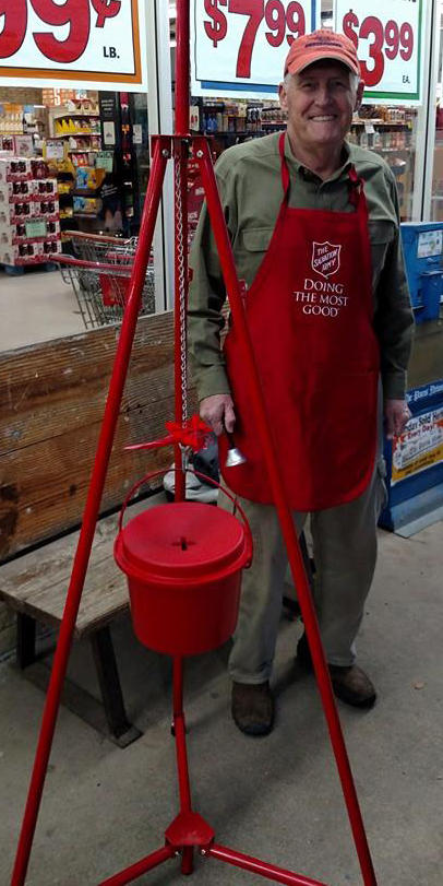 Salvation Army bell ringer Neil Clark encourages others to help with the cause.