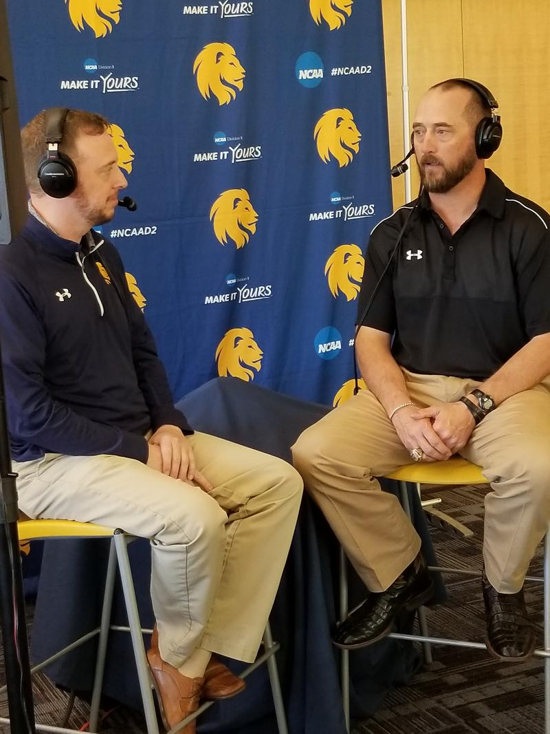 Manck also talks with head football coach Colby Carthel after the team's double OT win at Central Washington.