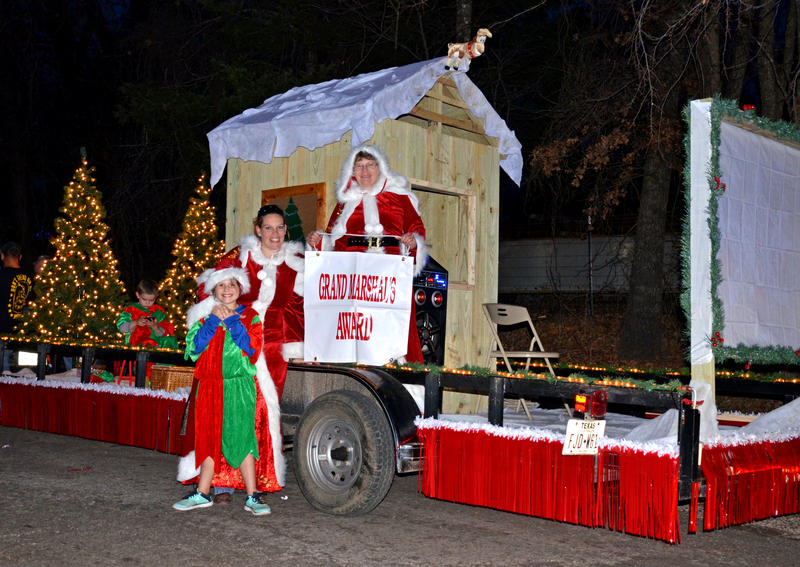 Keri Fouse and Tammi Springett and elves with the Cooper Outlet put on their best Mrs. Claus suits for their Grand Marshal Award-winning White Christmas float.