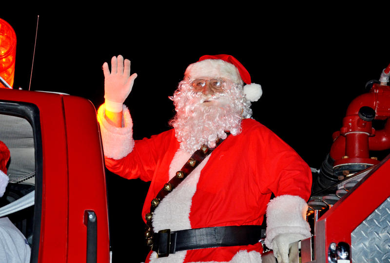 Santa Claus rode into town on the fire truck.