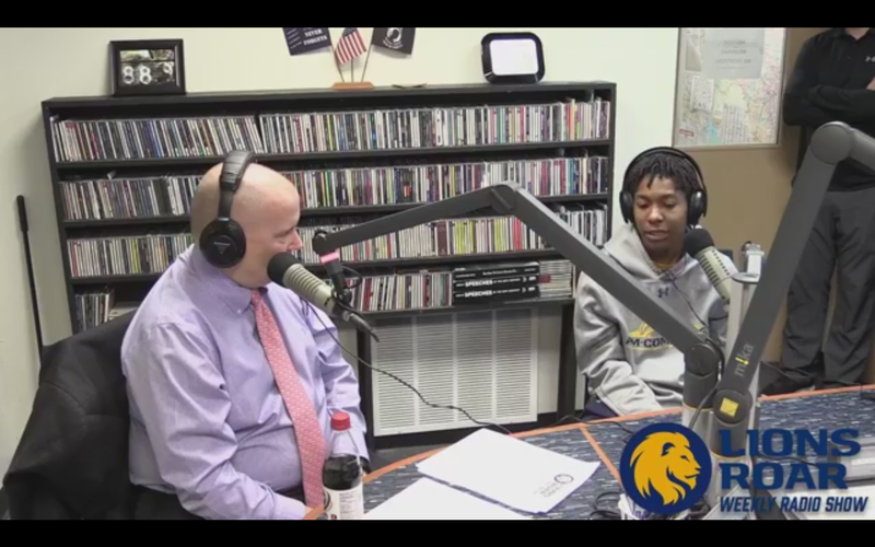 Tim McMurray talks with women's basketball guard Princess Davis about the team's first-place standing in the Lone Star Conference.