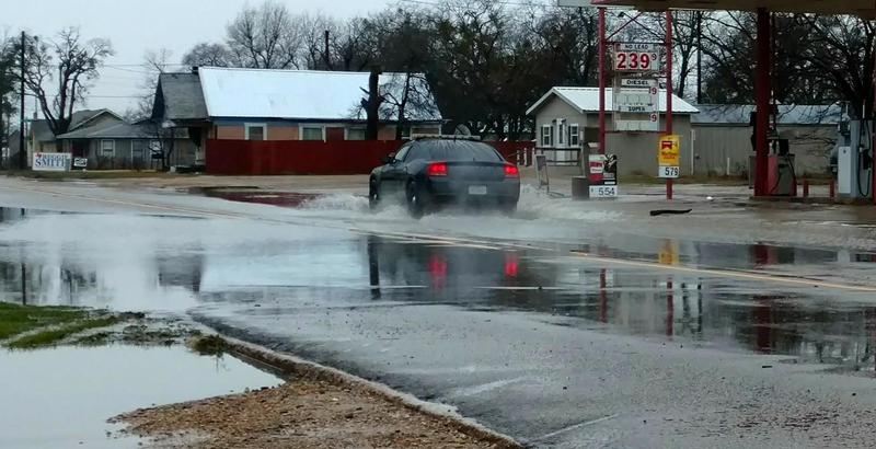 Delta County Constable Marshall Lynch assists TxDOT in monitoring flooded roads like West Dallas Avenue in Cooper.