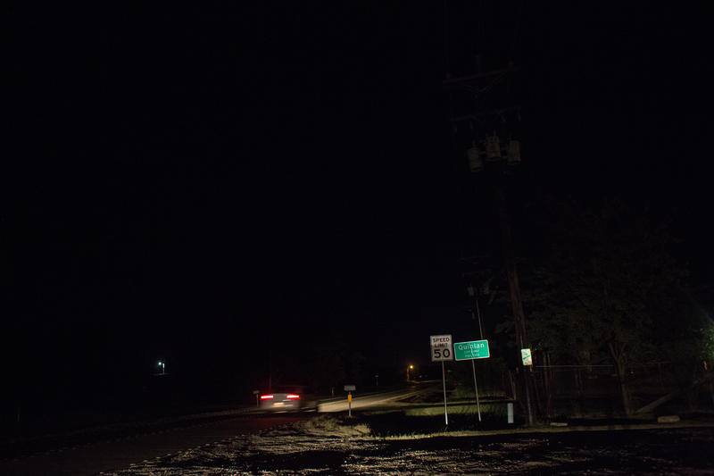 A car drives across the Quinlan, TX, city limits.