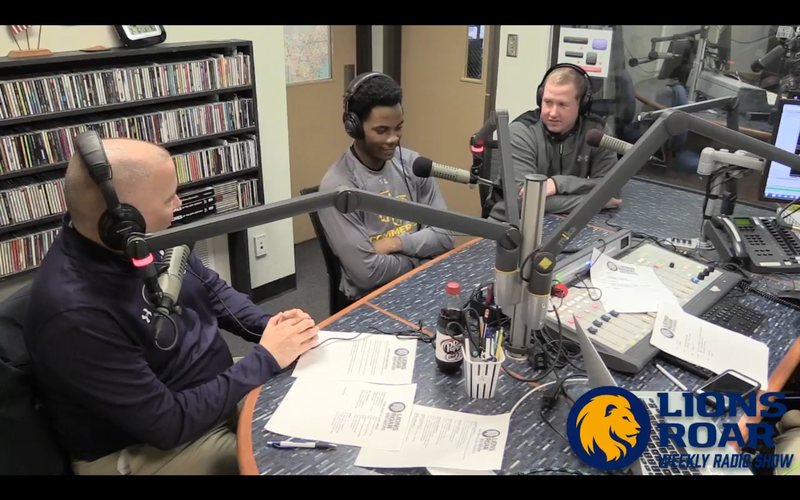 Tim McMurray talks with men's basketball coach Jaret von Rosenberg and forward Joseph Williams-Powell.