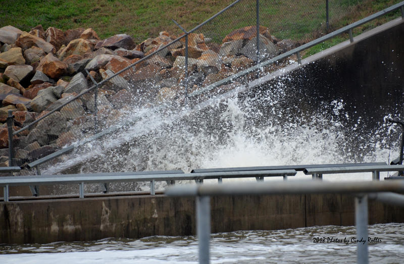 Cooper Lake rushes through the spillway after weeks of rain.