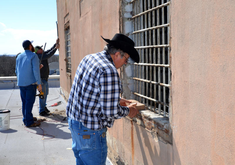 Delta County Commissioners like Precinct 4 Mark Brantley work on breaking into the old jail on top of the Courthouse in order to fix water leaks.