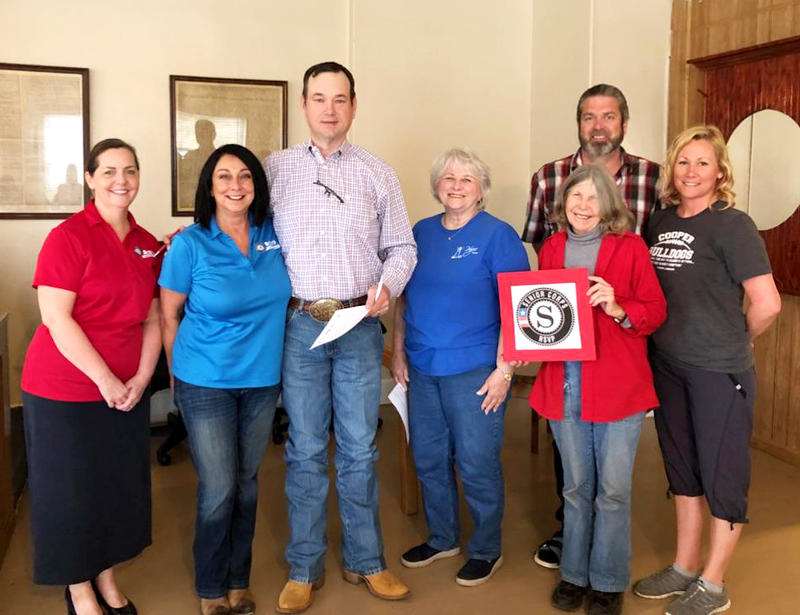 RSVP Coordinator Kelly Hamill, RSVP Volunteer Coordinator Jacel Angel, Delta County Judge Jason Murray, along with Delta County Hope House volunteers Patricia Smith, Lynne Morris, Laura Gillean, and Cooper Mayor Darren Braddy were at the proclamation Mond