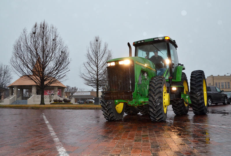 Gus Young brought his John Deere out in the rain for National FFA Week.