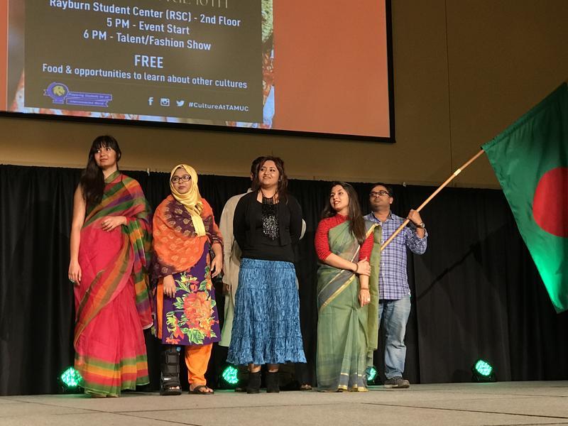 Bangladeshi students gather to present a traditional dance.