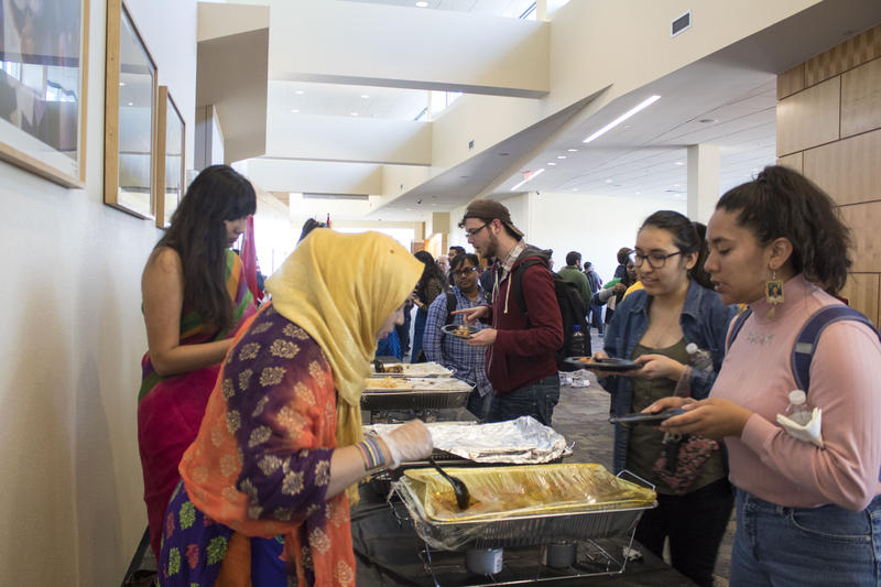 Bangladeshi students sharing their food with others.