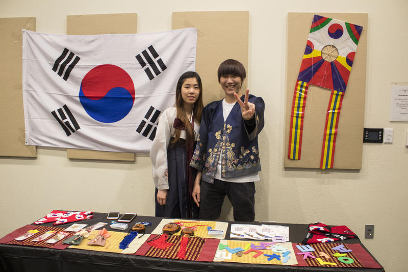 Korean students show items about their country and language.