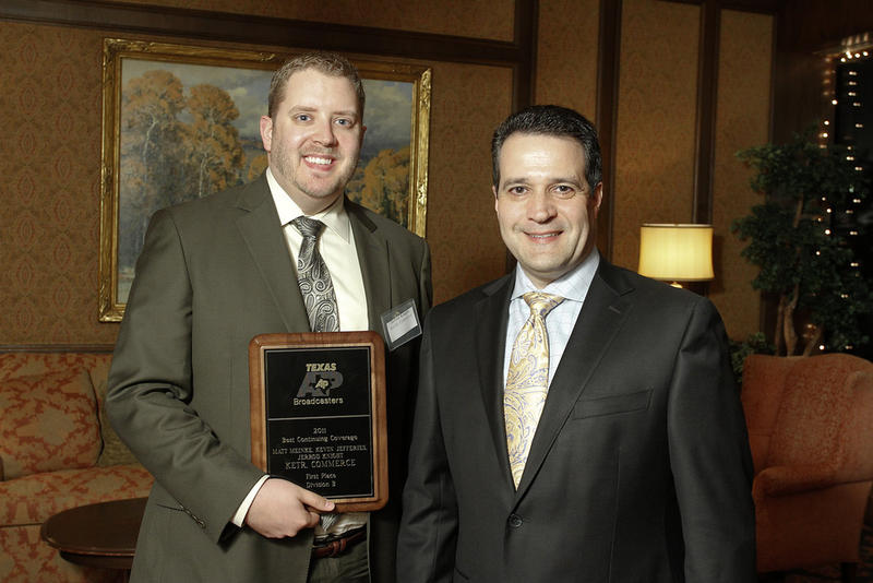 Jerrod Knight accepts an award from the Texas Associated Press Broadcasters.