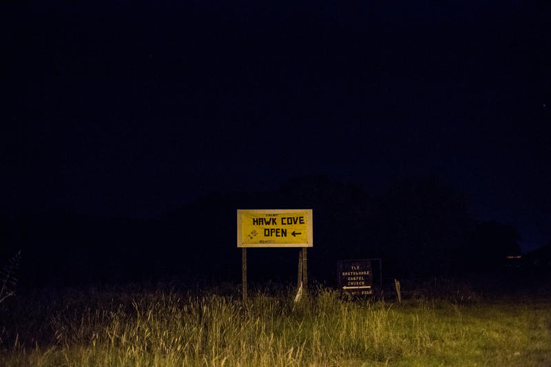 A sign points toward the Lake Tawakoni-area town of Hawk Cove, TX.