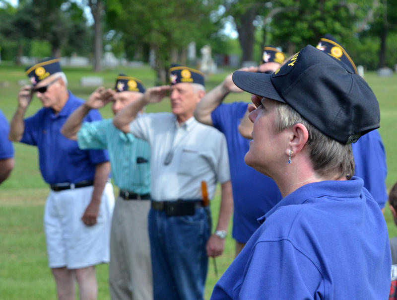 The local American Legion salutes the flag in honor of Memorial Day.