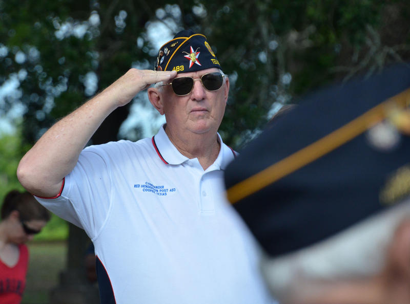 Post 483 Commander Gary Thompson led the services before placing flags on headstones.