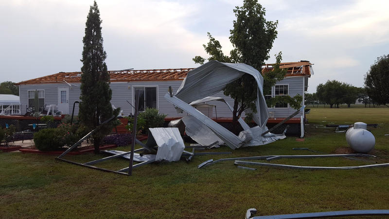 This home in Westowne area on County Road 2000 had the roof torn off in Saturday's storm.
