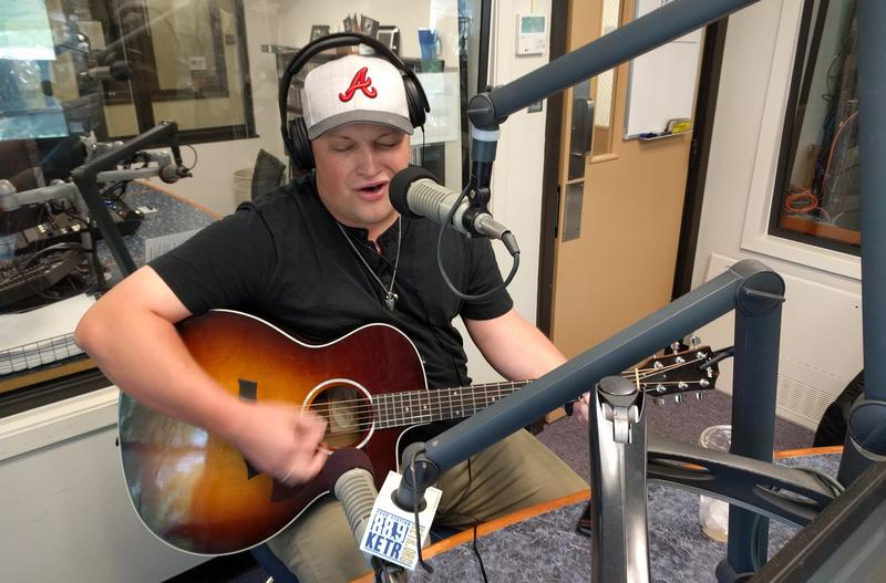 "Zach Coffey performed his song ""Over Ain't Over"" while at KETR."