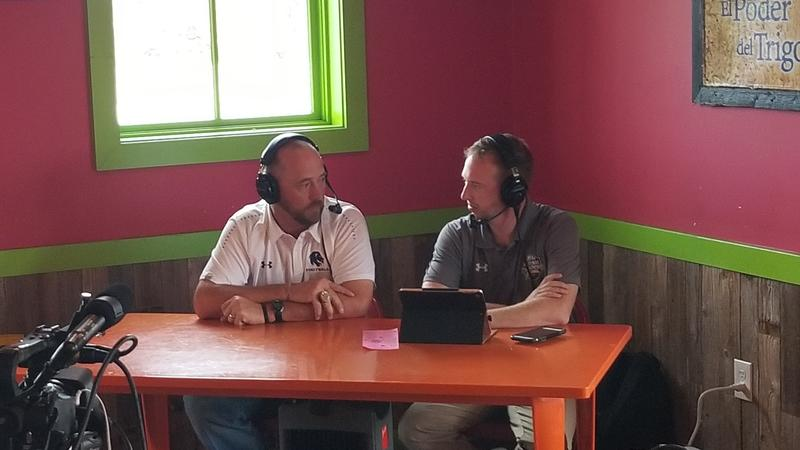 Josh Manck talks with head football coach Colby Carthel about the thrilling double overtime victory in the season opener.
