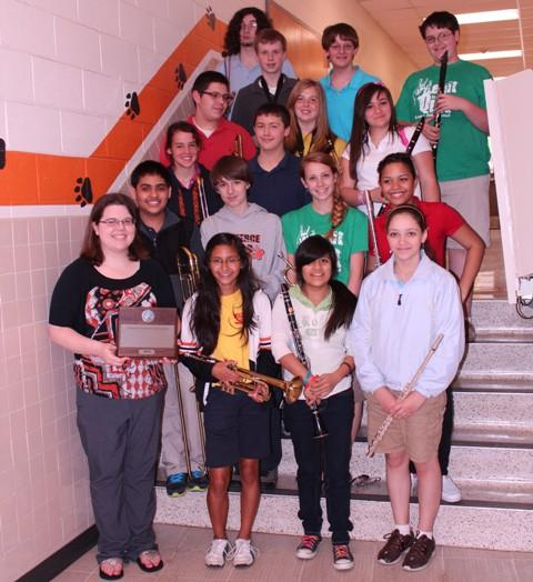 CMS Band Director Elizabeth Bialecki (front row left) is shown with eighth graders who participated in the competition.