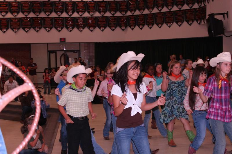 "Fifth graders performed a line dance to ""Should of been a Cowboy,"" inspired by their recent trip to the State Capital, which was funded by the Foundation"