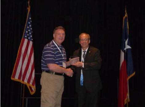 Police Chief Dan Busken receives the 2012 TPCA Innovation Award from Plano Police Chief and TPCA President Greg Rushin