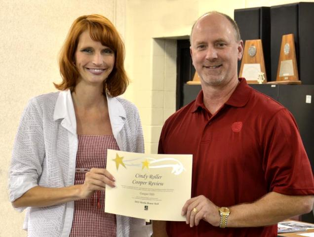 Cindy Roller receives Media Honor Roll Award from Cooper ISD Board President Thomas Darden Monday.