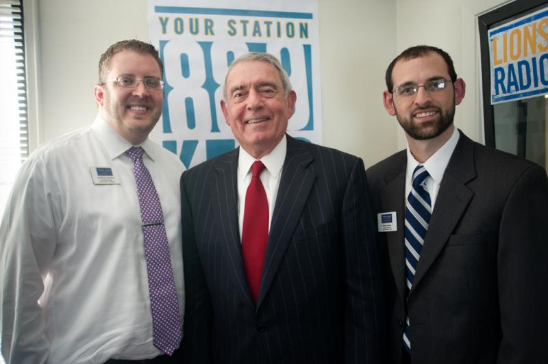 Dan Rather poses with KETR's GM Jerrod Knight and News Director Scott Harvey.