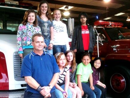 Chief Ruziicka gave Girl Scout Troop 3926 a tour (front row from left) Ashlyn Copeland, Mattie King, Marissa Welch, Megan Harris, (back row) Madison Allen, Madyson McMurtre, Harley Blanchard and Eva Harris