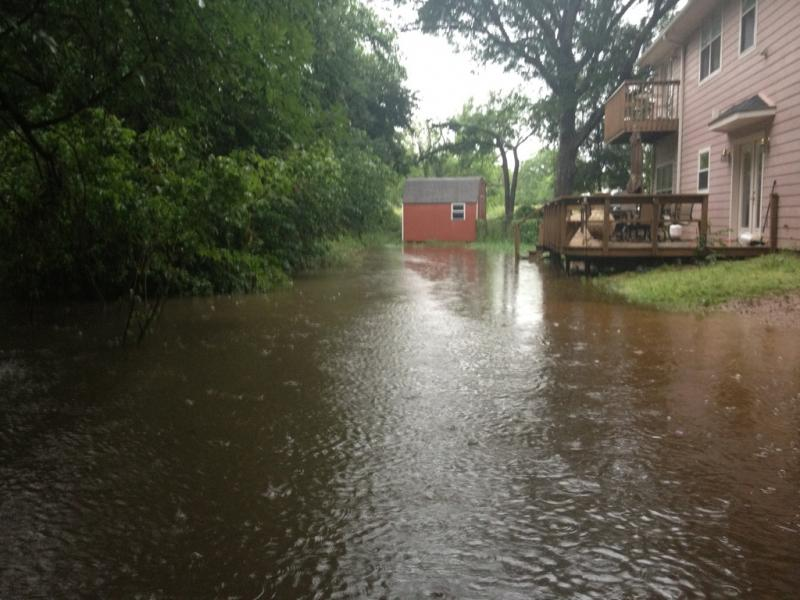 Flooding behind a residence in Commerce