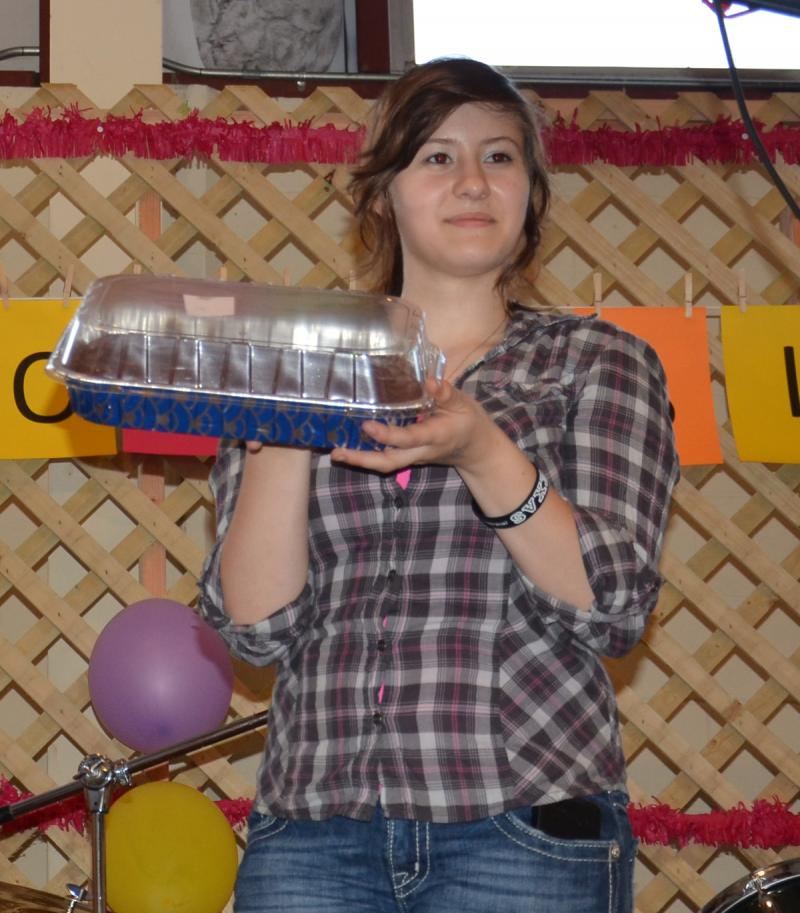 Courtney Poole, granddaughter of a cancer survivor, helps with the Cake Auction at Saturday's American Cancer Society benefit in Cooper.