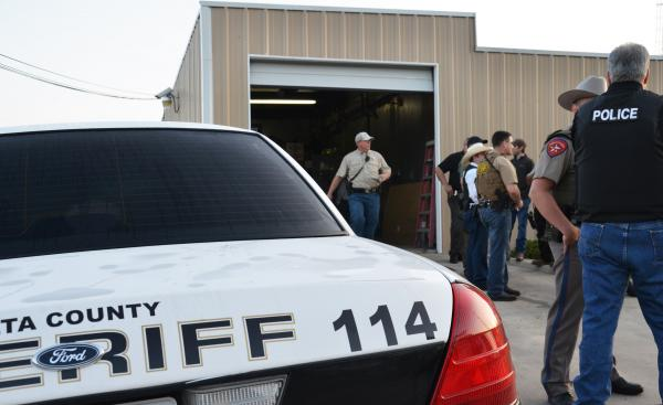 Officers from multiple law enforcement agencies coordinated efforts in the early morning service of 19 arrest warrants in Delta County.