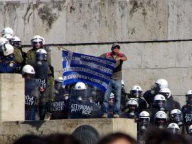 A protester defies the national police force of Greece on October 19, 2011