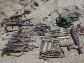 Members of a combined Afghan and coalition security force collected a cache of weapons after clearing a known Haqqani network foreign fighter encampment site in Paktika province, Afghanistan - July 21, 2011.