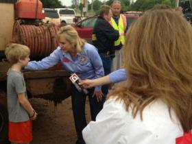 Gov. Mary Fallin speaks to a young victim of Sunday's tornado that tore through Carney, Okla.