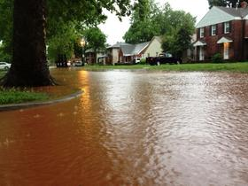 Flooding at College Ave. one block north of Lindsey Street in Norman, Okla. from thunderstorms Thursday morning.