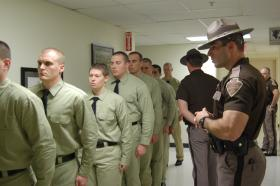 Oklahoma Highway Patrol cadets lining up during academy training.