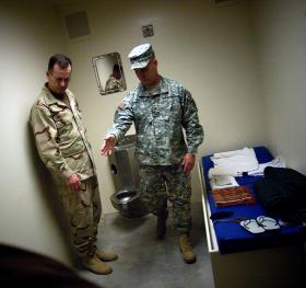 Col. Bruce Vargo, the joint detention group commander at Guantanamo Bay, gives a tour of a detainee holding cell to Adm. Mike Mullen, Chairman of the Joint Chiefs of Staff - January 13, 2008