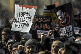 Turkish protesters chant slogans during a demonstration against the government of Syria's President Bashar al-Assad at Beyazit Square in Istanbul, on March 18, 2012