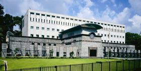 "The U.S. Embassy in Singapore. It opened November 1, 1996 ""with with a crenelated walkway is set back from the main road a considerable distance to protect it from bomb blasts."""