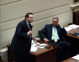 State Sen. Clark Jolley debates for passage of a $7.1 billion state budget bill while Senate President Pro Temp Brian Bingman looks on.
