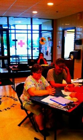 Local residents register with Red Cross at the Little Axe Resource Center