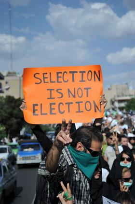 A demonstrator holds a sign in Tehran on June 16, 2009.