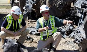 NTSB recorders expert Doug Brazy briefs Board Member Mark Rosekind at the scene of the Union Pacific freight train accident.
