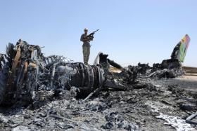 Libyan rebels play on the body of a plane destroyed during heavy fighting at Tripoli International Airport on August 29, 2011.