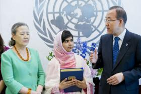 United Nations Secretary-General Ban Ki-moon (right) meets with Malala Yousafzai (center) on July 12, 2013. The Secretary-General presented her with a leather-bound copy of the United Nations Charter, which normally is given only to heads of state.