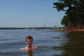 A swimmer in Norman's Lake Thunderbird.