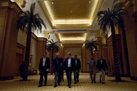 U.S. Secretary of Defense Chuck Hagel, second from left, talks with Deputy Assistant Secretary of Defense for Middle East policy Matthew Spence, center, in Abu Dhabi, United Arab Emirates, April 25, 2013. Hagel spoke with Spence after announcing to reporters that the White House had released a statement saying it had evidence that Syrian President Bashar al-Assad had used chemical weapons against Syrian rebels.
