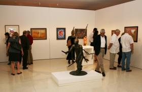 Patrons viewing works at the Fred Jones Jr. Museum of Art during James T. Bialac Community Day 2012.