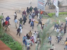 Crowds flee the sound of gunfire near the Westgate shopping mall in Nairobi, Kenya - September 21, 2013.