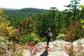 A hiker navigates through Robbers Cave State Park near Wilburton, Okla.